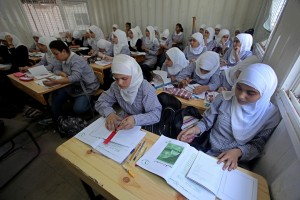 "Palestinian students crammed in the schools of Relief and Works Agency refugees ""UNRWA"""